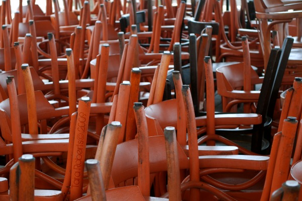 stacks of red and black chairs
