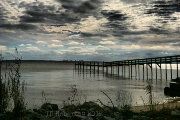 storm clouds and pier