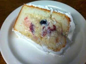 cut strawberry cream cake