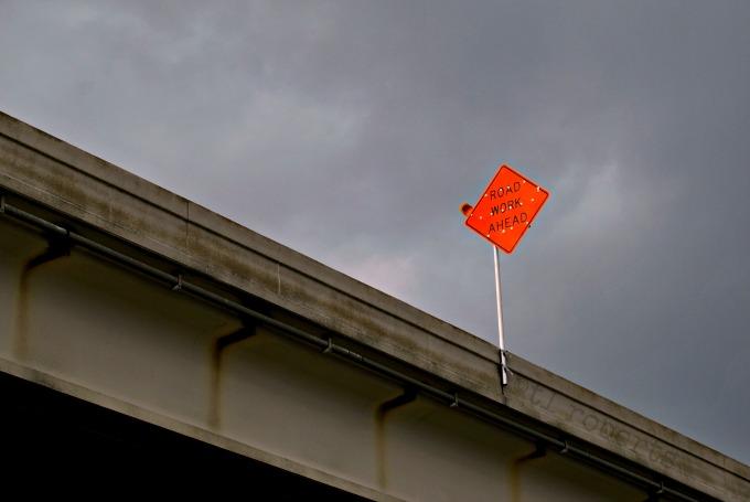 road work sign on bridge