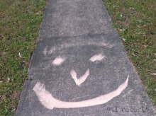 sidewalk smiley face