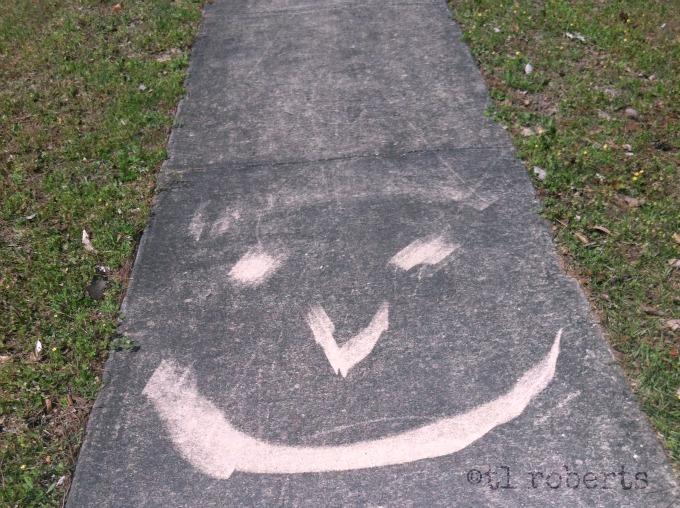 sidewalk smiley face