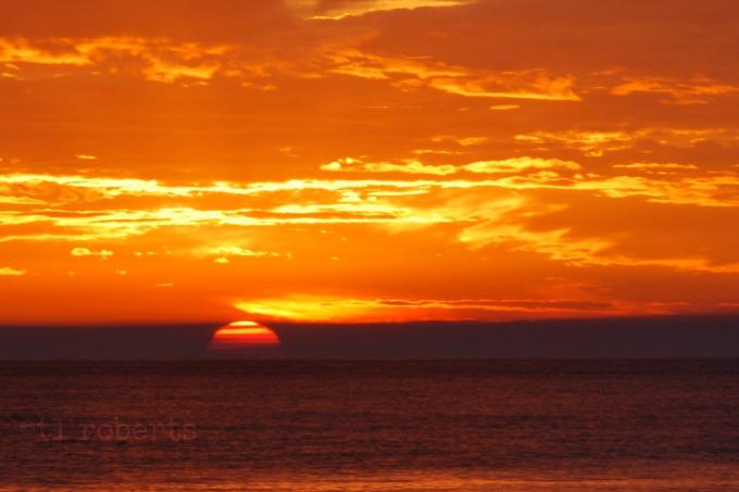 blood orange sunset at the beach