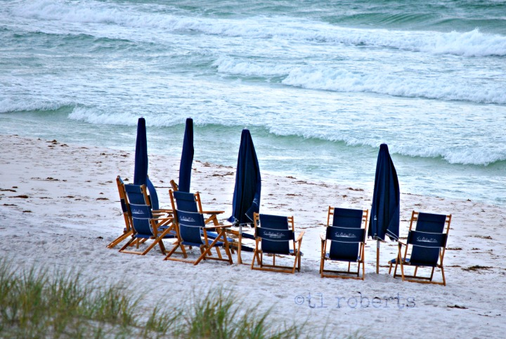 blue beach chairs on white sand