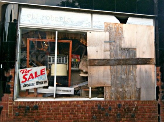 abandoned store front window