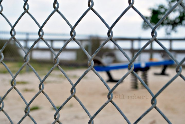 view of playground through chain link fence