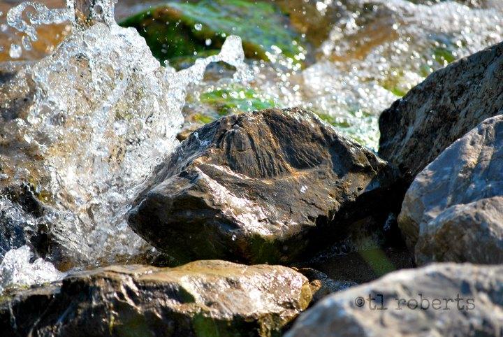 breaking waves on rocky shore