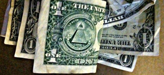 handful of one dollar bills