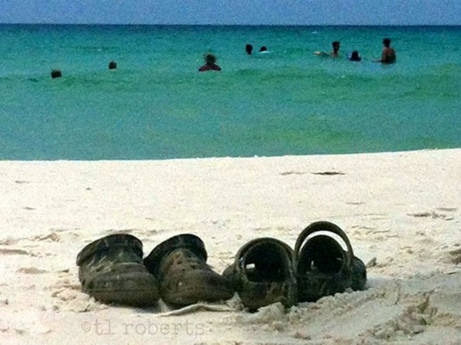 Camouflage Crocs on the beach