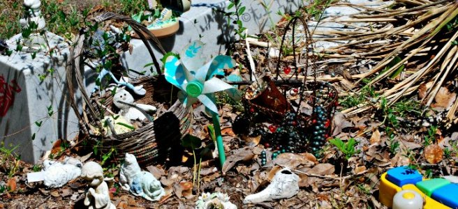child grave site with toys