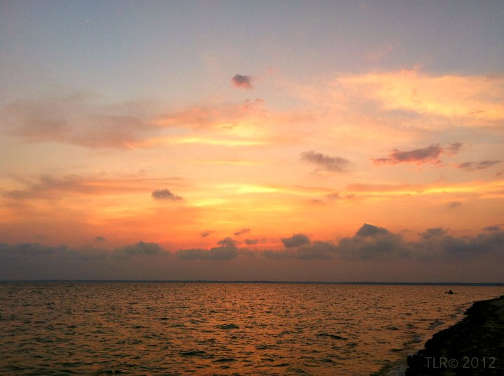 kayak on the ocean at sunset