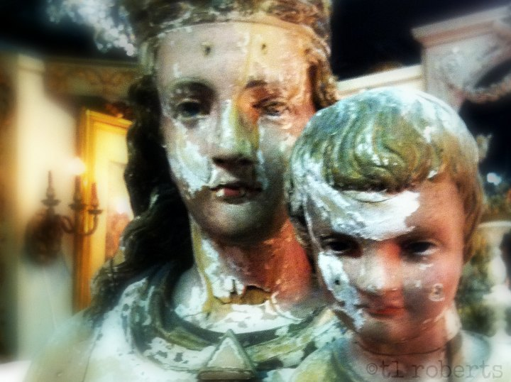 wooden statue of mother and child