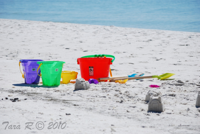 toy shovel and pail on beach