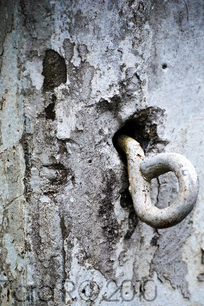 metal hook in stone post
