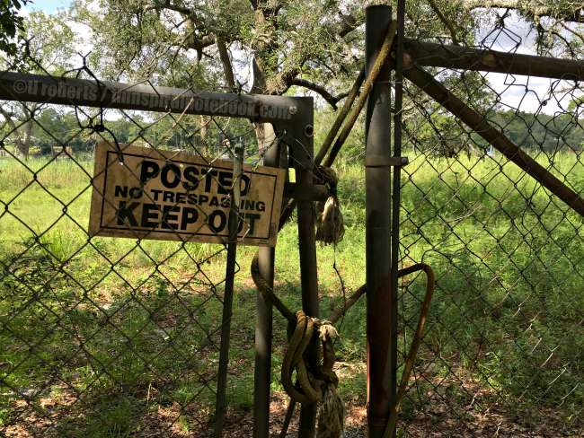 Keep Out sign on old chain link fence