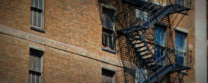 fire escape on brown brick building