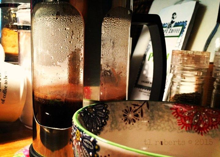 French press and coffee mug