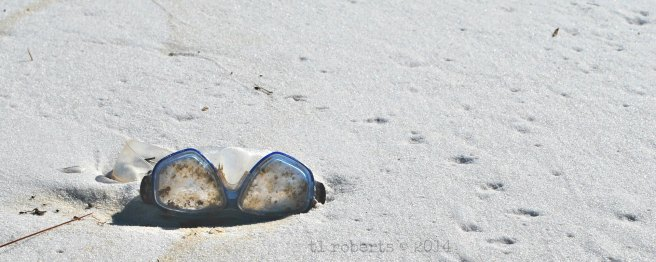 swimming goggles on beach