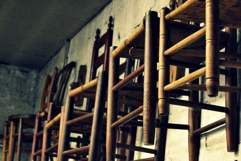 wooden chairs hanging on a wall
