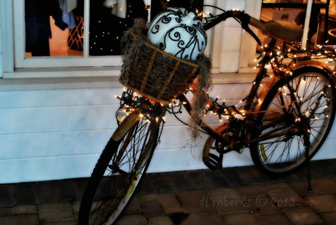 bicycle and white string lights
