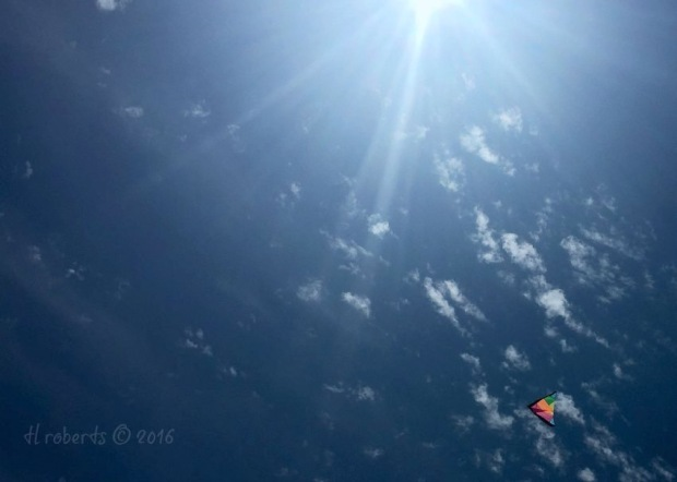 colorful kite in deep blue sky
