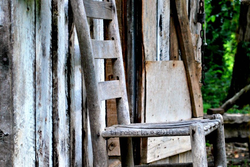 old chair on cabin porch