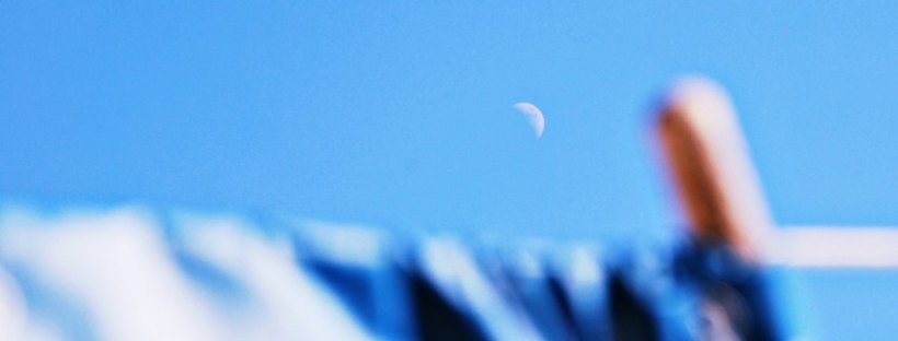waxing crescent in day sky
