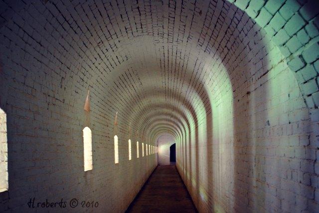 narrow white brick passage