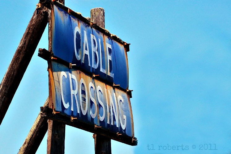 rusty cable crossing sign