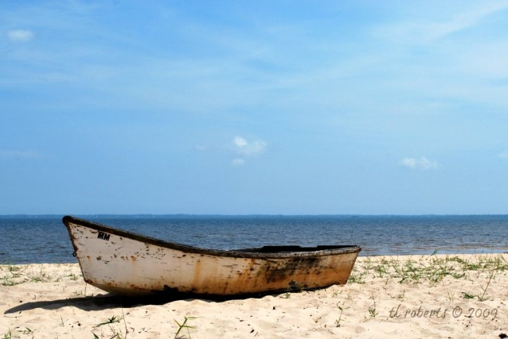 marooned boat on a sandy beach