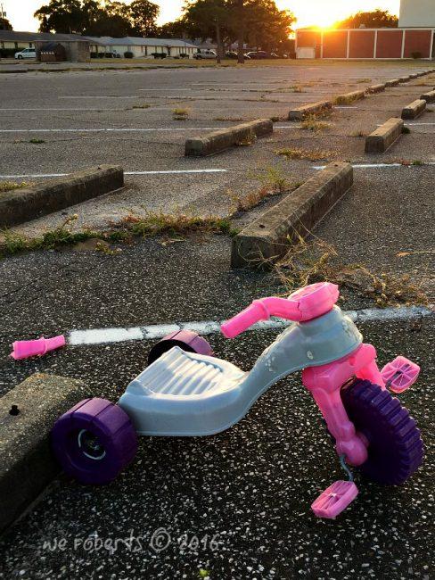 broken pink big wheel tricycle