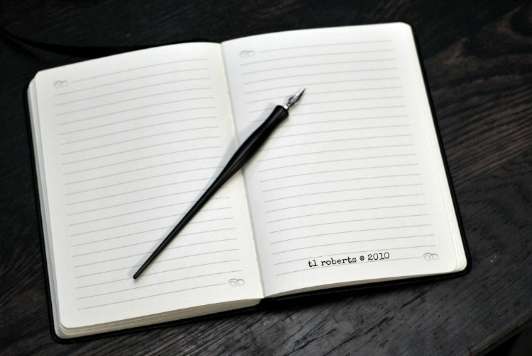 blank journal and quill