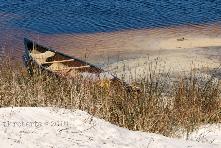 grounded canoe on sandy bank